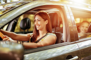Woman and Child With Car Insurance